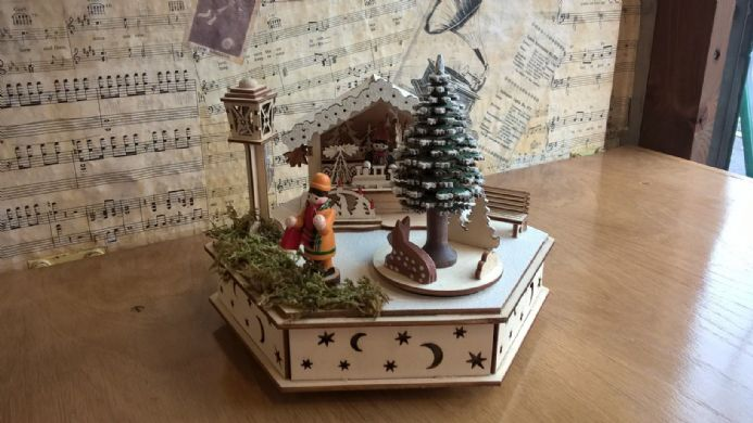 An unusual Wooden Musical Christmas Market Scene